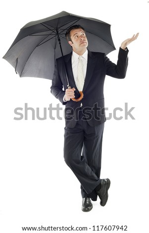 businessman protected by an umbrella on an isolated background - stock photo