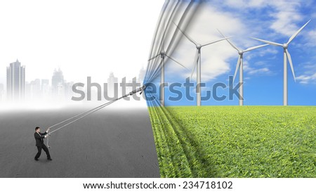 businessman pull open wind turbines curtain covering gray cityscape background, environmental protection and alternative energy concept - stock photo
