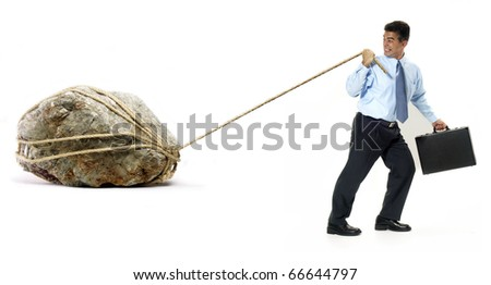 Businessman pulling a big rock on white background. - stock photo