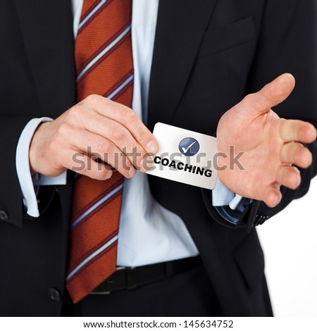 businessman pulling coaching card out of his sleeves - stock photo