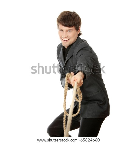 Businessman pulling on a rope. Isolated on white - stock photo
