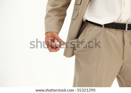 Businessman pulling out his empty pocket isolated on white - stock photo