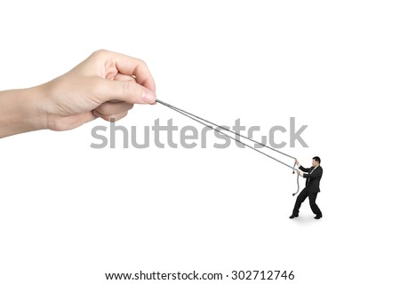 Businessman pulling rope against big woman hand, isolated on white. - stock photo
