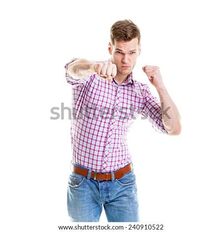 Businessman punching isolated on a white background - stock photo