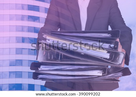 businessman push many file with office background,Accounting and business concept,pastal tone - stock photo