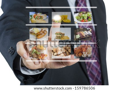 Businessman push virtual button screen in restaurant,isolated on white background - stock photo