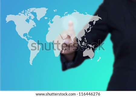 Businessman pushing a button on a world map. - stock photo