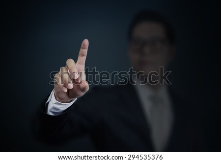 Businessman pushing a transparent screen. Business technology, internet and networking concept. - stock photo