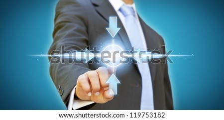 Businessman pushing arrow button