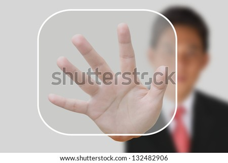 Businessman pushing  button on the white background - stock photo