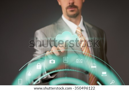Businessman pushing cloud button on virtual touch screen