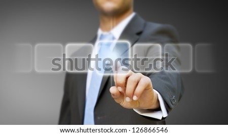 Businessman pushing digital button - stock photo