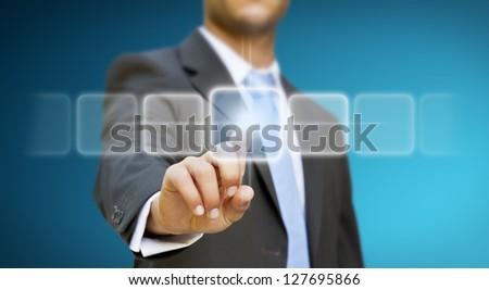 Businessman pushing digital button concept - stock photo