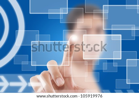 Businessman pushing digital button on touch screen interface.