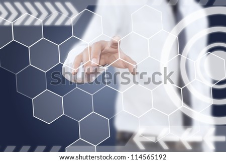Businessman pushing digital button on touch screen interface. - stock photo