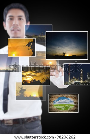 Businessman pushing digital button with images. - stock photo