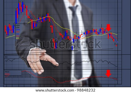 Businessman pushing finance graph for trade stock market on the whiteboard. - stock photo