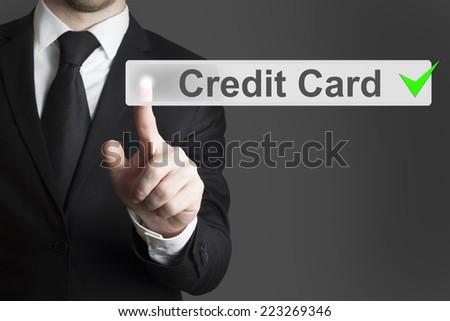 businessman pushing flat button credit card - stock photo