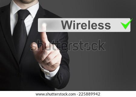 businessman pushing flat touchscreen button wireless - stock photo