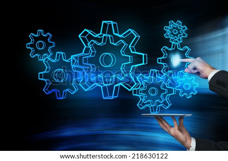 Businessman pushing holographic interface. New approach to business management. - stock photo