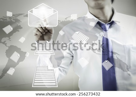 businessman pushing mail on world map,email concept - stock photo