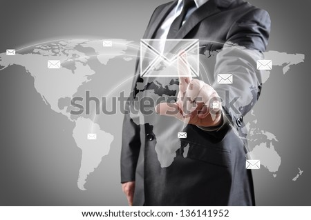 businessman pushing mail on world map on a touch screen interface. - stock photo