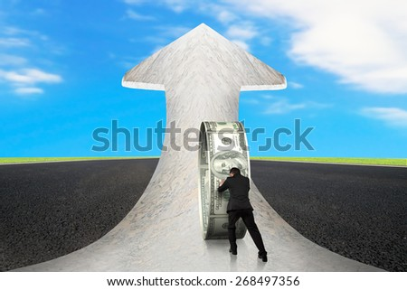 Businessman pushing money circle on arrow up sign marble road with asphalt pavement and sky clouds background - stock photo