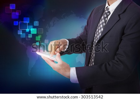 Businessman pushing on a touch screen interface on a tablet  - stock photo