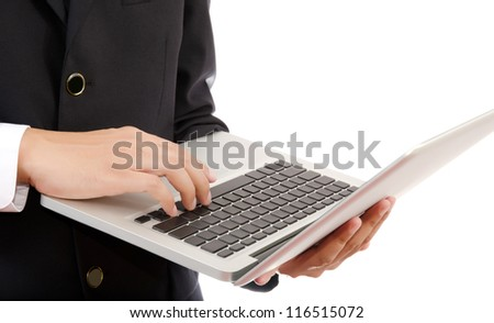 Businessman pushing on laptop keyboard for Business Concept.
