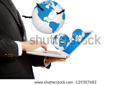 Businessman pushing on laptop keyboard for Business Concept with World Map Globe. with airplane around the globe. - stock photo