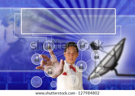 Businessman pushing people Social Network on the Satellite dish transmission data background - stock photo