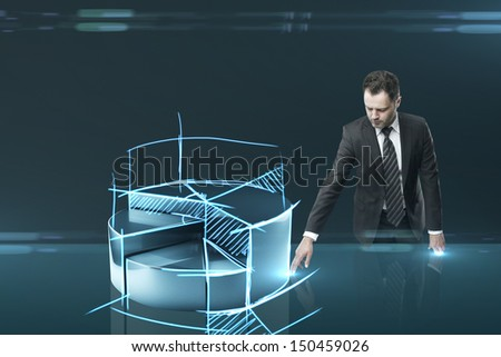 businessman pushing pie chart  interface on table - stock photo