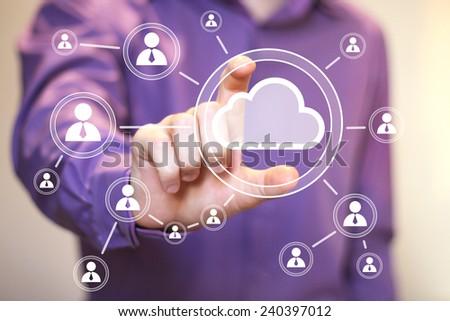 Businessman pushing virtual button cloud icon - stock photo