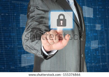 Businessman pushing virtual security button on digital background   - stock photo