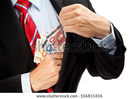 Businessman putting money in his pocket. - stock photo