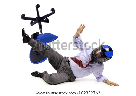 Businessman racer crashing in a chair with helmet - stock photo