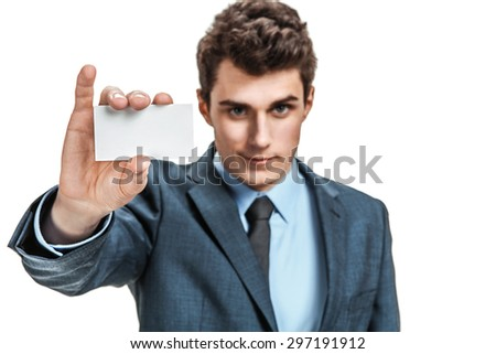 Businessman reach out on camera and show credit card or visiting card / photos of young businessman wearing  a suit and tie over white background - stock photo