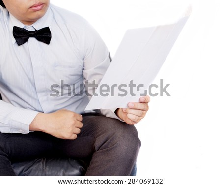 Businessman read a note - stock photo