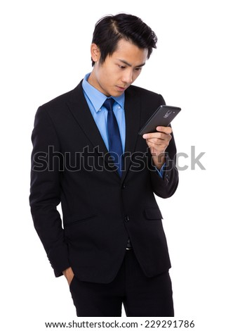 Businessman read the message on cellphone