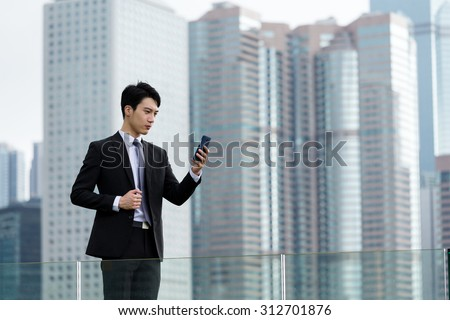 Businessman read the message on cellphone - stock photo