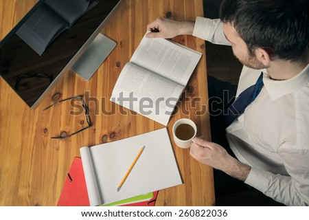 Businessman reading  - stock photo