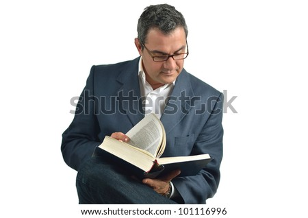 Businessman reading a book sitting in a chair. isolated on white background - stock photo