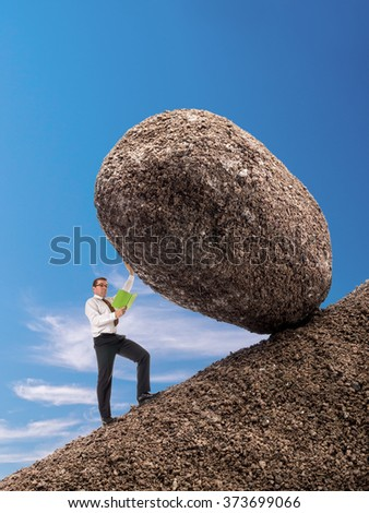 Businessman reading a book standing on slope blocking easily giant boulder with one hand from falling down - stock photo