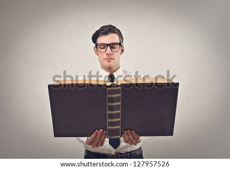 businessman reading a huge book - stock photo