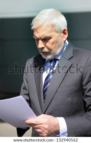 businessman reading a report - stock photo
