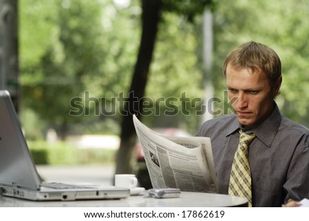 businessman reading newspaper - stock photo