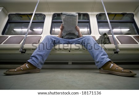 businessman reading newspaper in metro carriage - stock photo