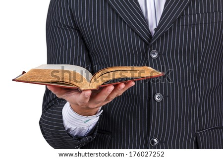 Businessman reading old book isolated - stock photo