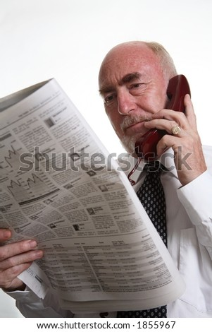 businessman reading paper