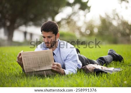 Businessman reading the newspaper - stock photo